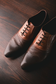 Men shoes on wooden surface