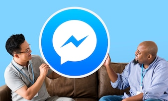 Men showing a Facebook Messenger icon