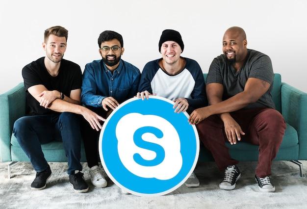 Men showing a skype icon