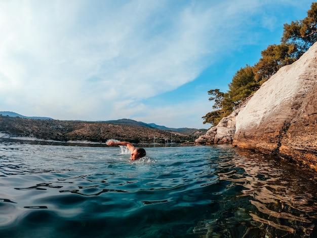 Men swimming in the sea