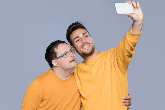 Men taking a selfie together