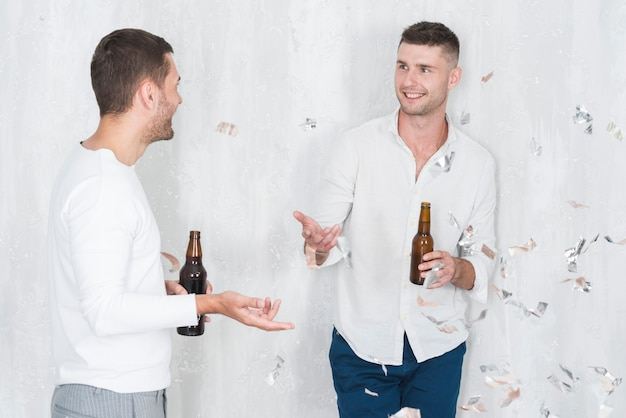 Men talking and drinking