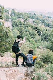 Men trekking in nature