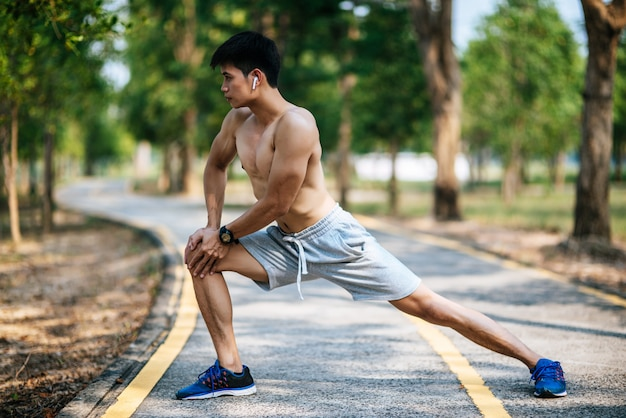 Men warm up before and after exercising