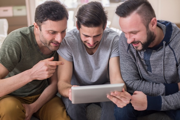 Men watching video on a tablet