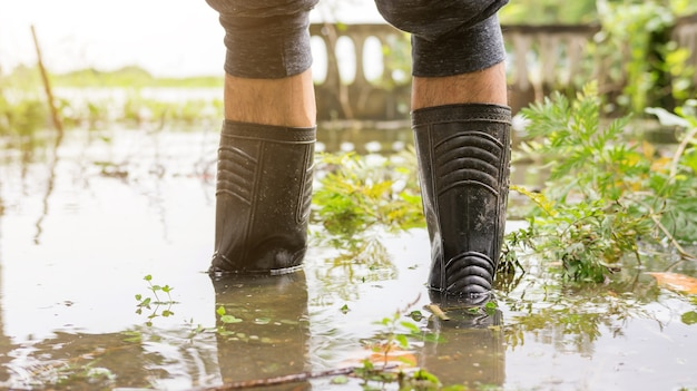 Men wear black boots for a flood