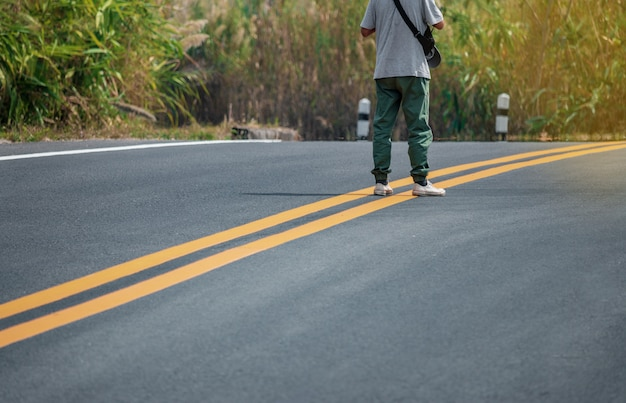 Men wearing sneakers walking on the streets with yellow lines.