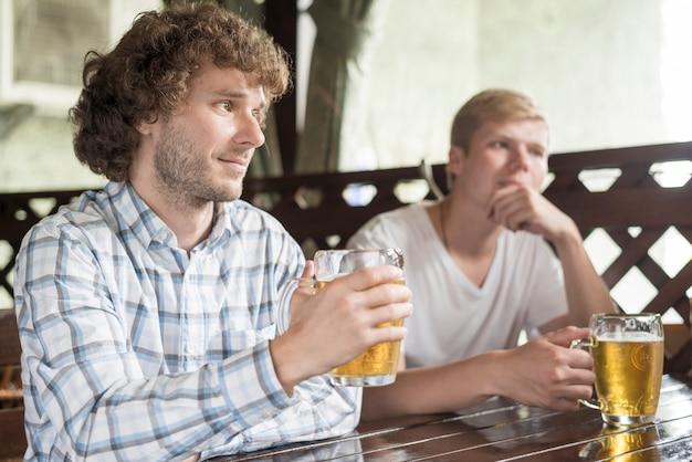 Men with beer listening tostory
