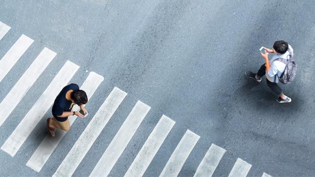 Men with smartphones walking on the street