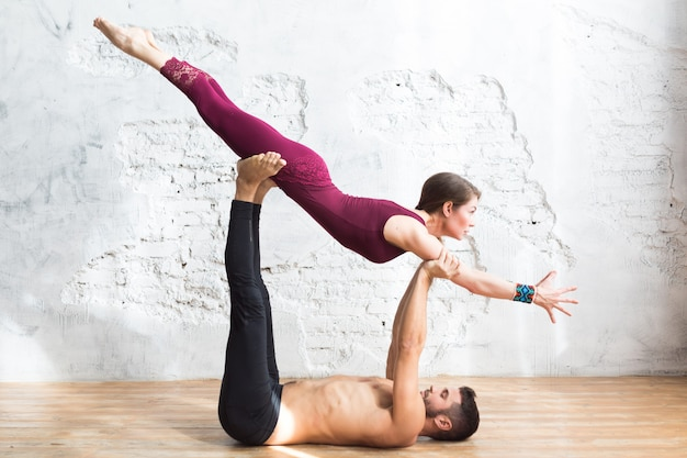 Men and woman, pair and acroyoga flexibility class workout
