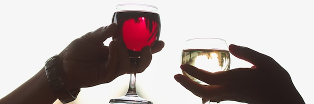 Men and women are holding glasses of red and white wine