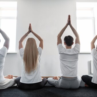 Men and women meditate on yoga classes. group of people love doing in stretching training.