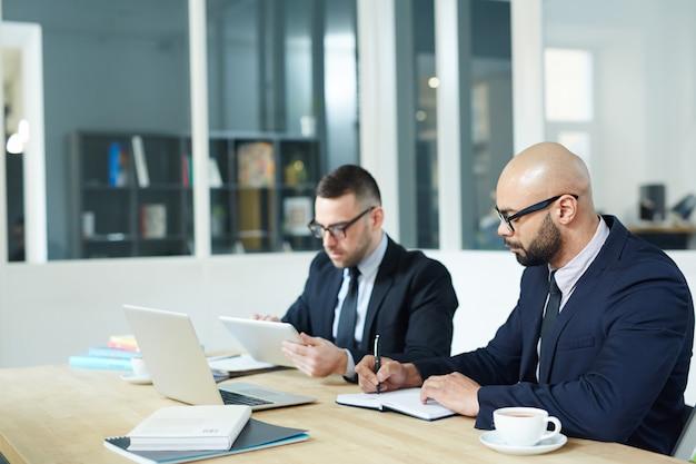 Men working in office