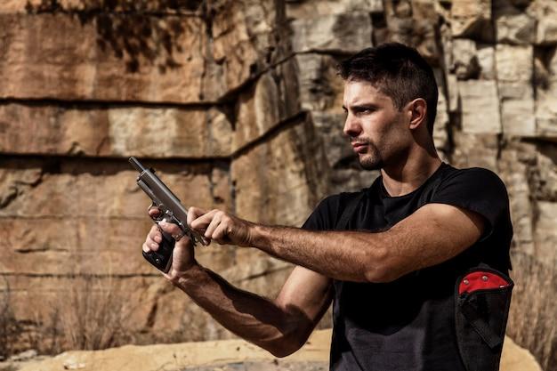 Menacing man with a handgun
