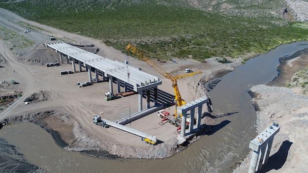 Mendoza, argentina, april 23, 2018: construction of a highway bridge over the rio diamante.