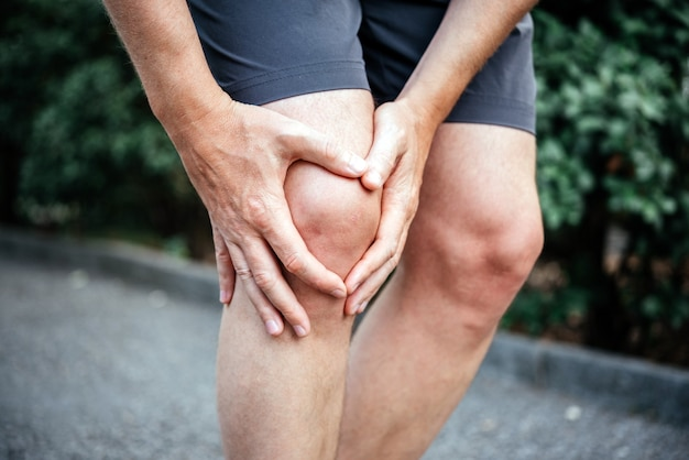 Meniscus tear in man athletes knee sports injuries concept