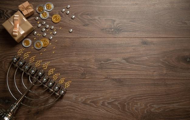 Менора, блестящие монеты, подарочные коробки. знамя хануки