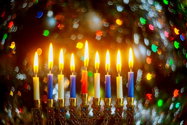 Menorah with burning candles for hanukkah on sparkle surface with defocused lights jewish holiday