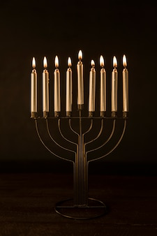 Menorah with golden burning candles