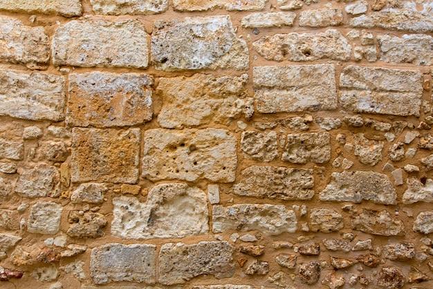 Menorca castle stonewall ashlar masonry wall texture