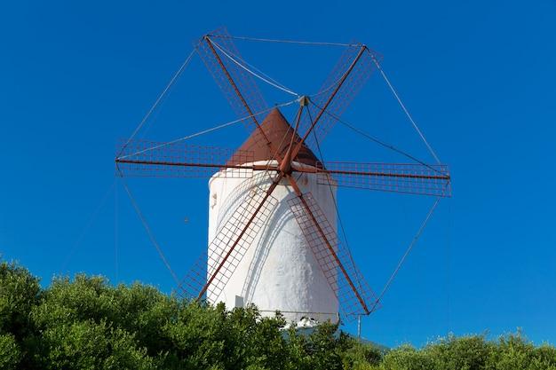 Menorca es mercadal windmill on blue sky at balearics