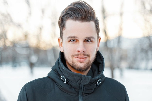 Mens handsome face with hair and beard in winter sunny day