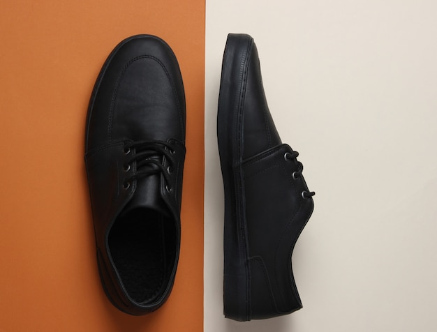 Mens leather black shoes on paper background