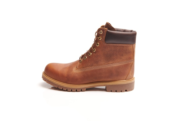 Mens leather brown waterproof boots for winter or autumn hiking isolated. mens fashion, trendy footwear. close up view.