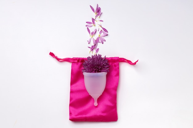 Menstrual cup with flowers on white