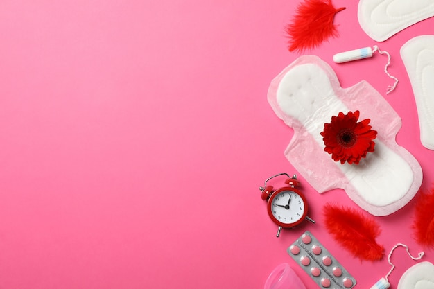 Menstrual period concept on pink surface