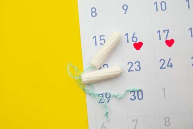 Menstruation calendar with cotton tampons.