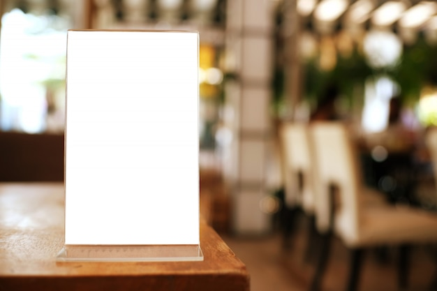 Menu frame standing on wood table in bar restaurant cafe. space for text marketing promoti