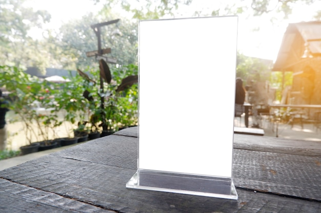 Menu frame standing on wood table in bar restaurant cafe