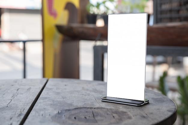Menu frame standing on wood table