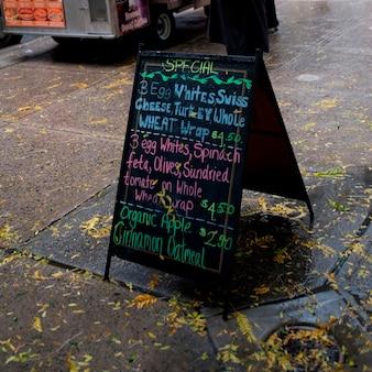 Menu sandwich board on sidewalk in manhattan, new york city, u.s.a.