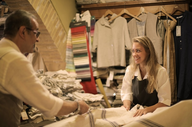 Merchandiser and shop assistant in a fabric shop