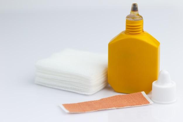 Mercurochrome, gauze and adhesive plaster on white background