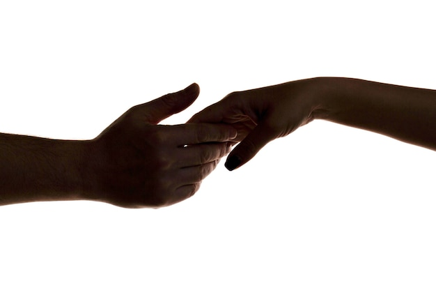 Mercy two hands silhouette connection or help concept finger touching hands silhouette man woman