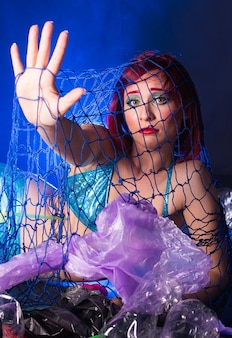 Mermaid scared due to polluted habitat.