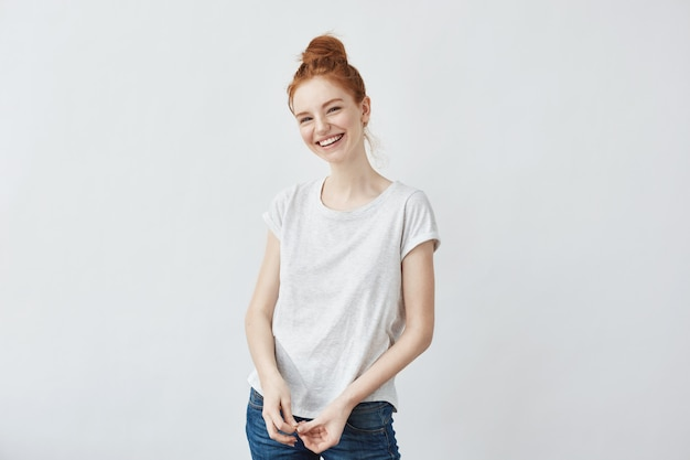 Merry beautiful redhead woman laughing.