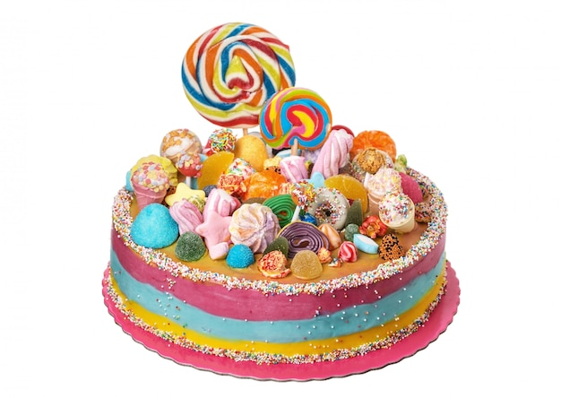 Merry cake made of sweets on day of birth of a girl.