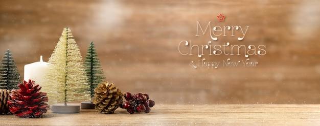 メリークリスマスと新年あけましておめでとうございます単語木製テーブルの上のクリスマスツリーの装飾