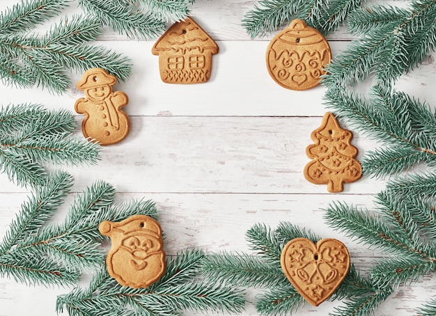 Merry christmas background tasty homemade ginger cookies. ingredients for cooking baking, kitchen utensils, gingerbread. happy new year greeting card. xmas table. fir tree, pine.