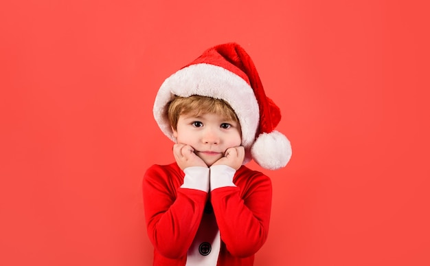 Merry christmas christmas time santa helper happy new year christmas kid in red hat new years