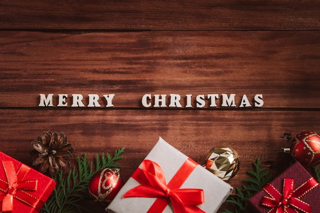 Merry christmas concept. beautiful gift boxes and fir branches on a wooden background.