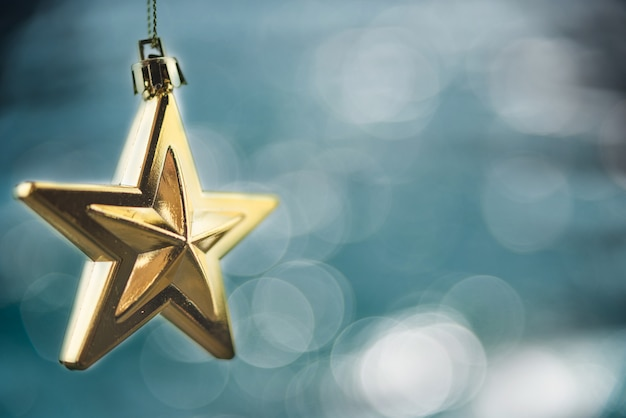 Merry christmas concept with hanging star ornaments