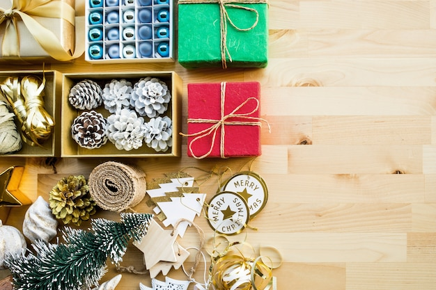 Merry christmas concepts with gift box present and ornament element on wood