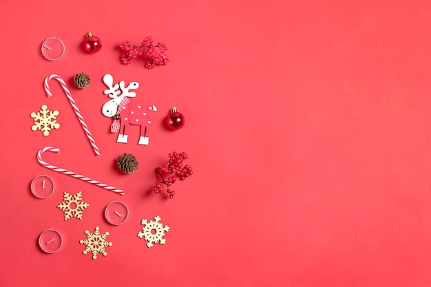 Merry christmas , decoration gifts, deer noel, cone, candy, snowflakes on red background
