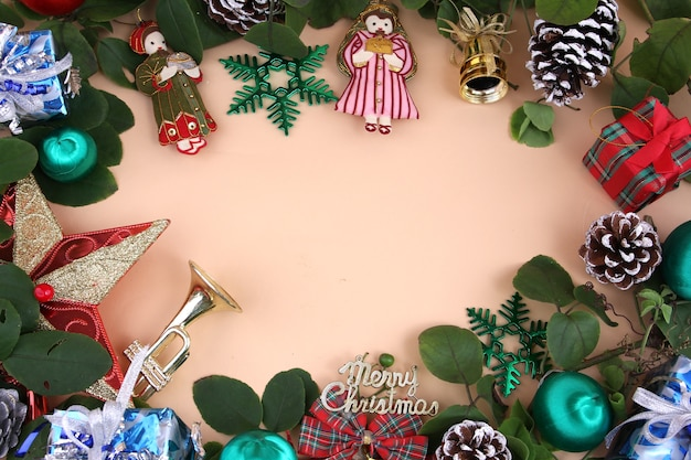 Merry christmas and decorations with light yellow background.