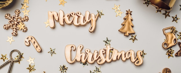 Merry christmas gold  shiny text with luxury xmas decoration items on white table
